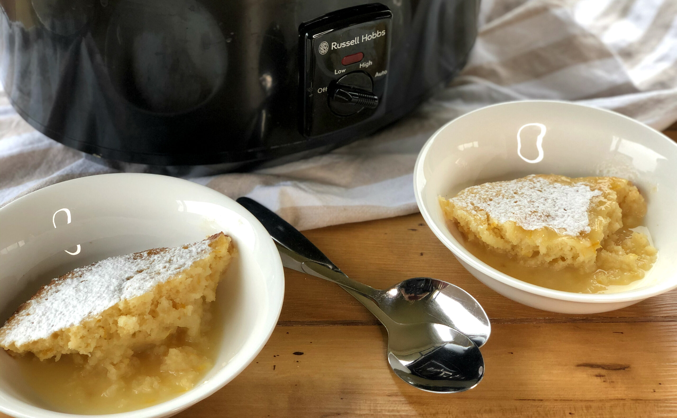 Russell Hobbs Slow Cooker with two bowls of lemon pudding